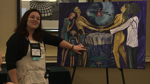 Regina Holliday paints at a conference