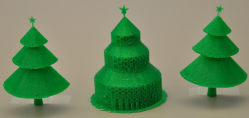 The tree in the center was printed with a traditional 3D printing algorithm, while the others were made with the new pyramid technique