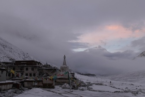 Rongbuk monastery in Tibet, near Mount Everest, which is peeking through the clouds. Here still extra-tall, in 2012.