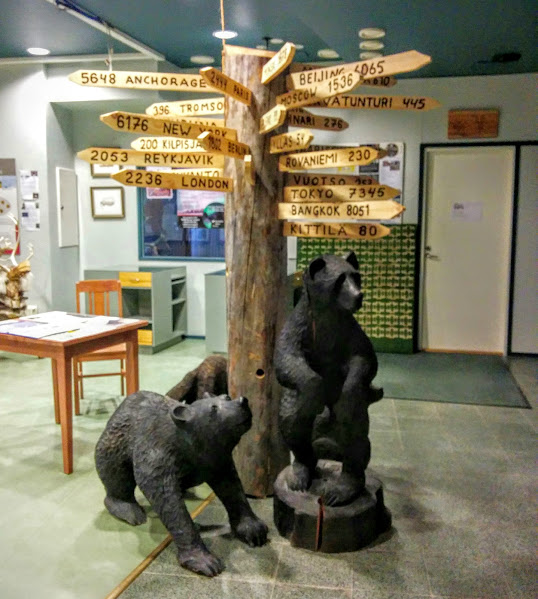 The visitor center at the Thai restaurant in Muoni shows the distance to Bangkok and Kilpisjarvi